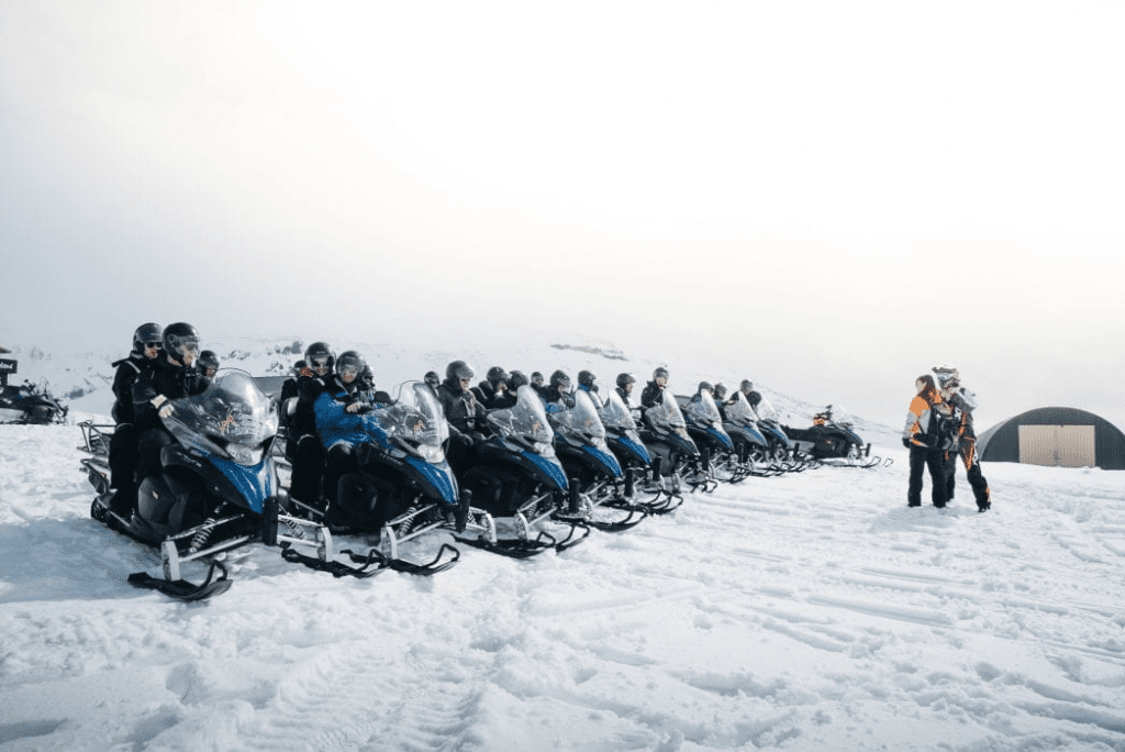 Snowmobiles lined up and ready to go